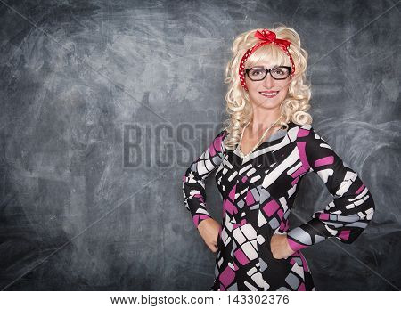 Retro teacher smiling on the chalkboard background