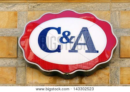 MUNICH GERMANY - AUGUST 3 2015: C&A brand logo. It is an international Dutch chain of fashion retail clothing stores with headquarters in Belgium and Germany.