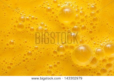 Beaten egg yolks surface in studio shot