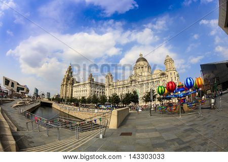 LIVERPOOL, UK - AUGUST:  Famous architecture at the waterfront in Liverpool, England.  Fish eye perspective.  August 18, 2016 in Liverpool.