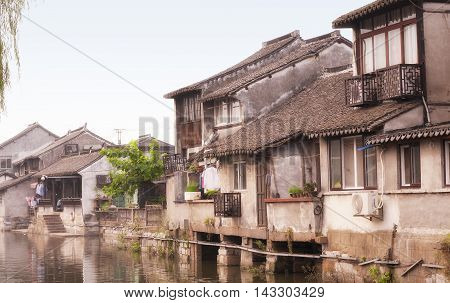 The buildings and water canals of Fengjing Town in Shanghai China on an overcast day.