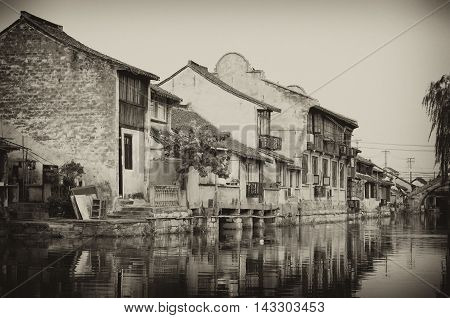 The buildings and water canals of Fengjing Town in Shanghai China in sepia tone.