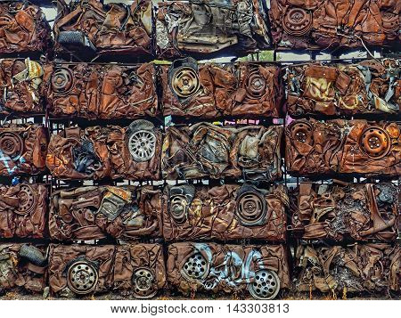 Scrap metal from cars compressed into blocks