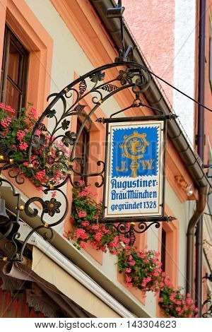 MUNICH GERMANY - AUGUST 3 2015: Augustiner Braeu sign near the Dom - A 670-year-old brewery & tavern founded on the site of a monastery known for it's Oktoberfest beers the oldest independent brewery in town.