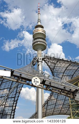 MUNICH GERMANY - AUGUST 4 2015: Detail of the Olympic Tower (Olympiaturm) in Olimpiapark. It was built for the 1972 Summer Olympics. It has an overall height of 291m and a weight of 52500 tons.