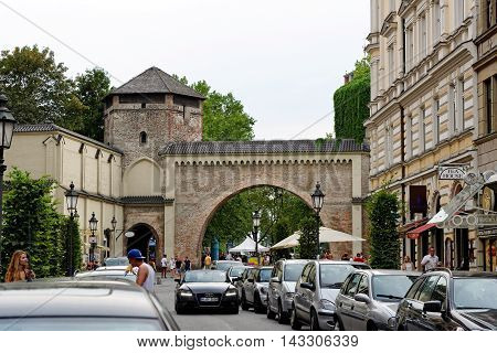 MUNICH GERMANY - 4 AUGUST 2015: Rear view of Sendlinger Tor and the begining of Sendlinger Strasse.