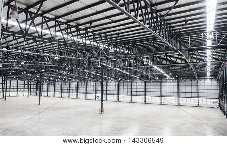 Large modern empty storehouse with safety equipment