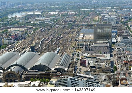 FRANKFURT AM MAIN GERMANY - AUGUST 6 2015: Aerial view of Frankfurt Central station from the observation deck of Main tower. It is the busiest railway station in Germany.