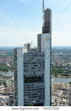 FRANKFURT AM MAIN GERMANY - AUGUST 6 2015: Aerial view of the Commerzbank tower from the observatory deck of the Main tower. It is the tallest building in Frankfurt and in Germany and the second tallest in the EU.