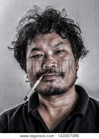 Adult man smoking a cigarette (Retro style)
