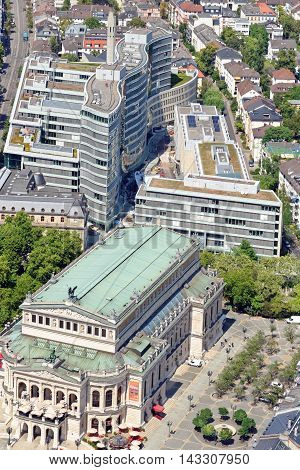 FRANKFURT AM MAIN GERMANY - AUGUST 6 2015: Aerial view: the Alte Oper (Old Opera House) and the Frankfurter Welle from the Main Tower. Frankfurt is the largest financial center in continental Europe.