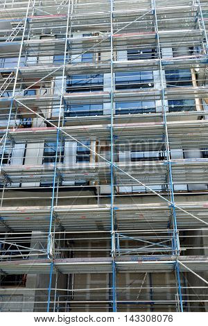 Fragment of scaffolding against house wall in Central Frankfurt am Main Germany.