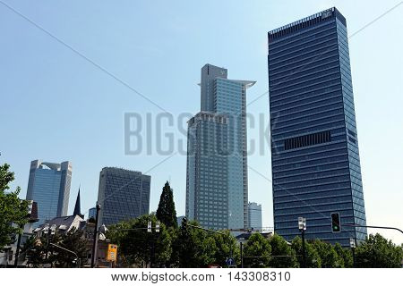 FRANKFURT AM MAIN GERMANY - AUGUST 7 2015: Highrise buidlings left to right Trianon FBC Westend Tower Tower 185. Frankfurt is a dynamic and international financial and trade city with the most imposing skyline in Germany.