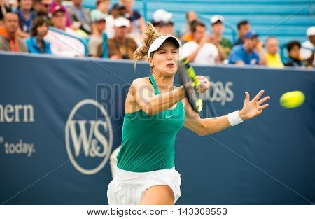 Mason Ohio - August 16 2016: Eugenie Bouchard in a match at the Western and Southern Open in Mason Ohio on August 16 2016.