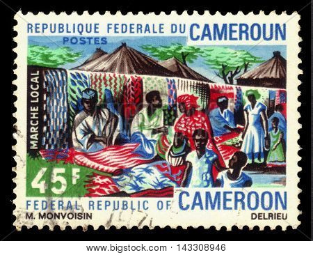 CAMEROON - CIRCA 1971: a stamp printed in Cameroon shows local market of carpets in the capital of Cameroon - Douala, circa 1971