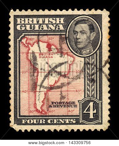 BRITISH GUIANA - CIRCA 1938: a stamp printed in British Guiana shows outlines of South America and portrait King George VI, circa 1938