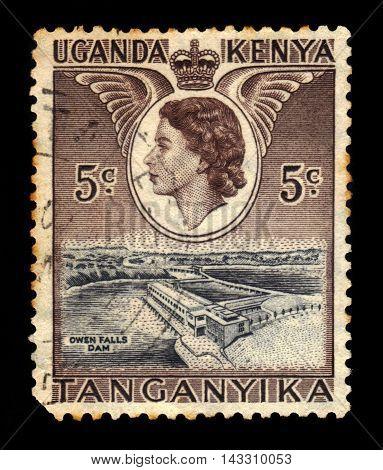 KENYA UGANDA TANGANYIKA - CIRCA 1954: A stamp printed in Kenya Uganda Tanganyika shows Owen falls dam and Queen Elizabeth II, circa 1954