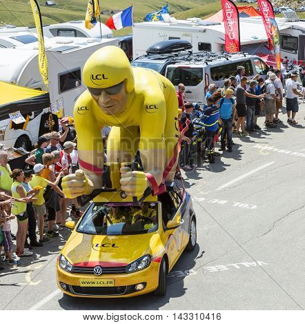 Col du Glandon France - July 23 2015: LCL characteristic vehicle during the passing of the Publicity Caravan on Col du Glandon in Alps during the stage 18 of Le Tour de France 2015. LCL was the largest bank in France and sponsored continuosly the TDF duri