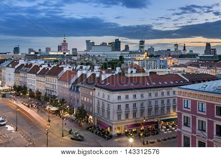 Top view of the old town with business region on the skyline in Warsaw on the evening