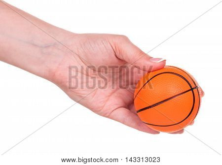 Small basketball toy ball in female hand over white background