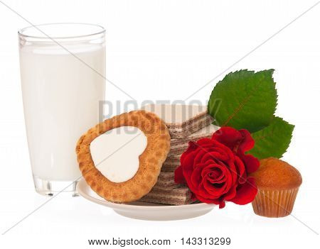 Milk with cookies and red rose for romanticism isolated on white background
