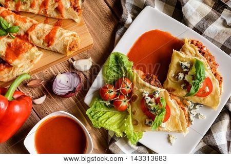 Stuffed Bolognese Pancakes With Minced Meat And Vegetable With Tomato Sauce
