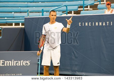 Mason Ohio - August 13 2016: Lukas Rosol argues a ball was out by inches in a qualifying match at the Western and Southern Open in Mason Ohio on August 13 2016.