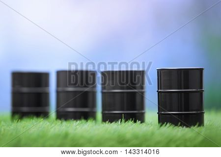 Four oil barrels in the grassland. Horizontal photo
