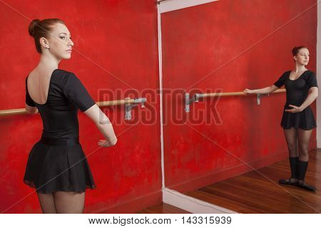 Ballerina Practicing In Front Of Mirror