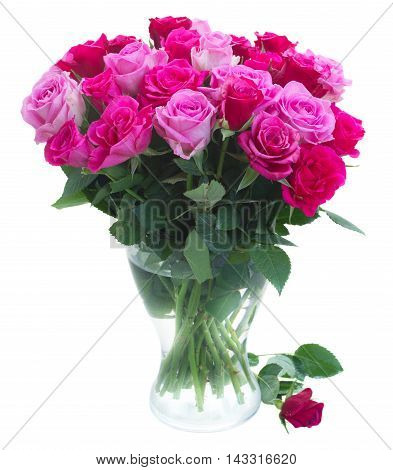 bouquet of pink and magenta fresh roses in glass vase isolated on white background