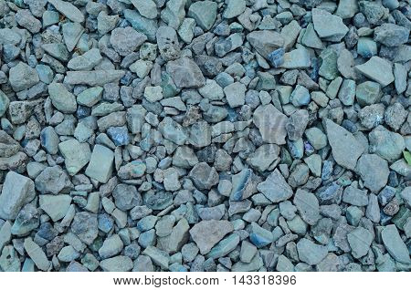 Background of gray gravel and crushed stone construction material for road