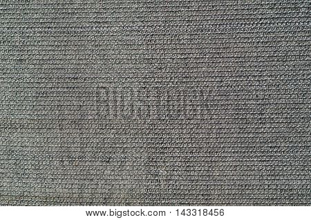 Texture of black shading net covering a house