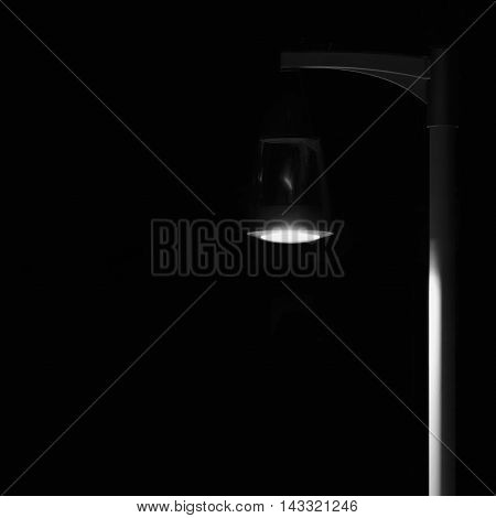 Bright Lit Outdoor Lantern Lamp Pole Post, Lonely Concept Solitude Metaphor, Illuminated Window Light, Vertical Deserted Night Park Scene Closeup, Black Isolated Copy Space Background