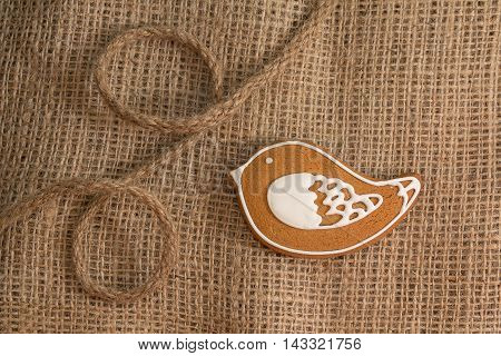 Cookies in the shape of a bird on a textile background. Food