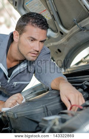 Man fixing a car engine