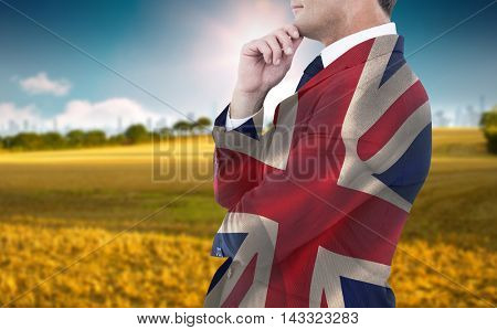 Elegant businessman in suit posing against digitally generated great britain national flag