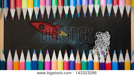 Coloured pencils against blackboard with copy space