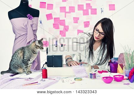 Fashion Designer Working With Sewing Machine