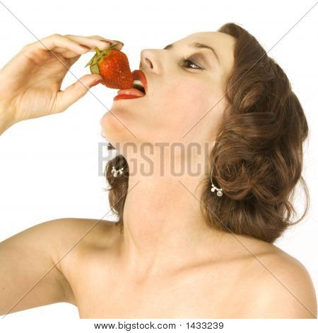 Beautiful Brunette Eating A Strawberry 2