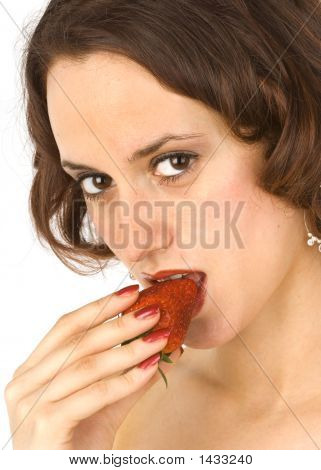 Beautiful Brunette Eating A Strawberry 1