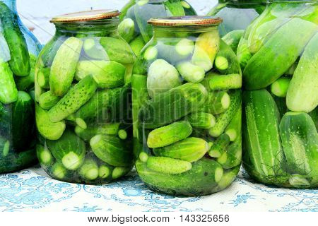 ripe cucumbers in the glass jars for preservation