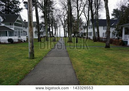 A sidewalk leads past homes to the beach in Wequetonsing, Michigan.