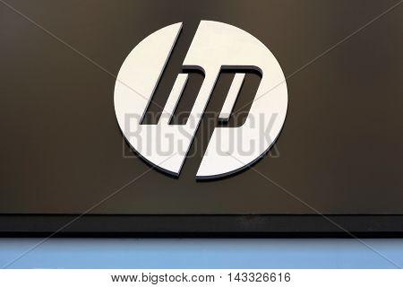 Lyon, France - August 15, 2016:  Hewlett-Packard sign on a wall. Hewlett-Packard Company commonly referred to as is an American multinational information technology company headquartered in Palo Alto, California