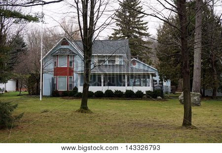 A blue home on Pennsylvania Avenue in Wequetonsing, Michigan, during December.