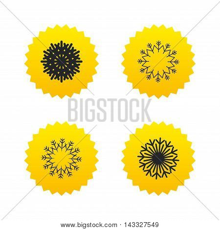 Snowflakes artistic icons. Air conditioning signs. Christmas and New year winter symbols. Frozen weather. Yellow stars labels with flat icons. Vector