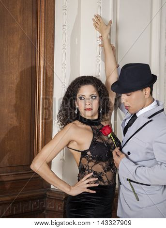 Tango Dancer Holding Rose While Standing With Female Partner