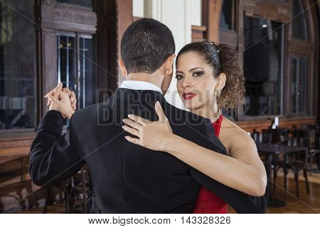Beautiful Tango Dancer Performing Gentle Embrace Step With Partn