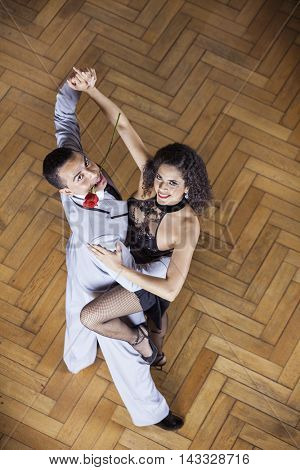 Confident Tango Partners Smiling While Performing In Restaurant