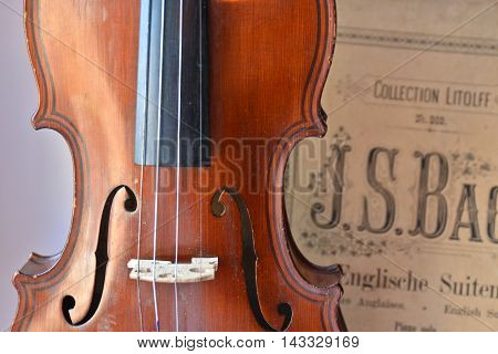 German ancient violin and notes. Old violin copy of Majini made Saxony in the 19th century.