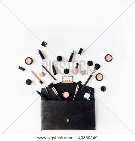 flat lay female cosmetics collage with lipstick brush on white background. top view set